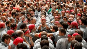 Castellers de Sants start to form a human tower called