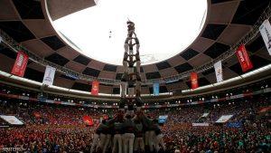 Castellers de Sants form a human tower called
